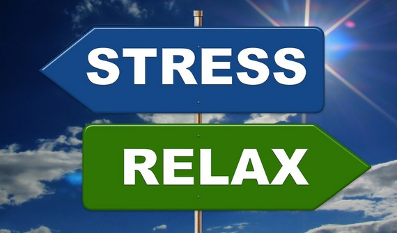 "Two signs, one with the word ""stress"", one with the word ""relax""."