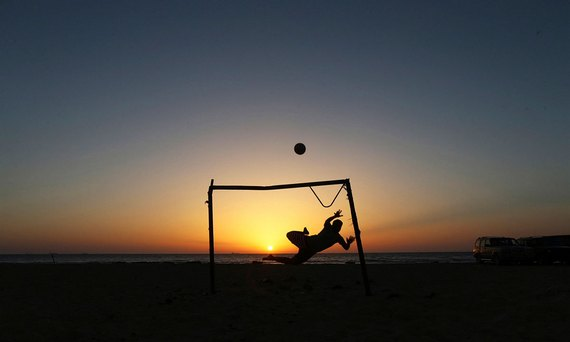 Playing soccer on beach