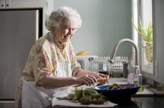 Elderly woman working in kitchen