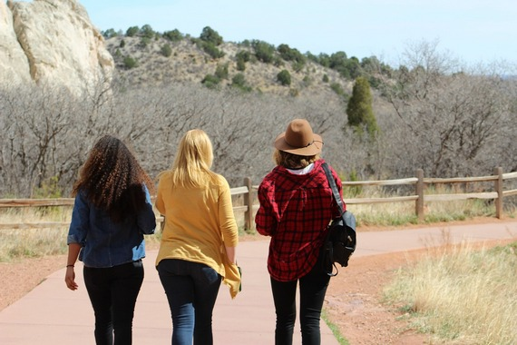 Three women friends walking